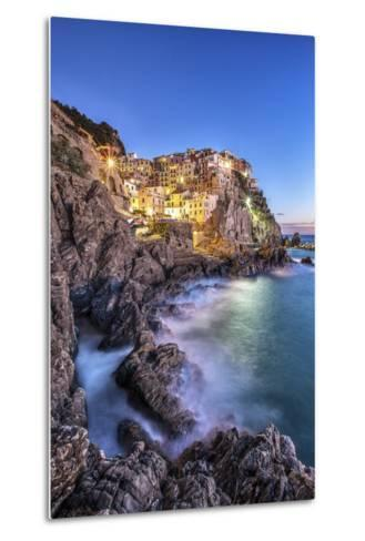 Manarola Village Illuminated by the Blue Light of Dusk with its Typical Pastel Colored Houses-ClickAlps-Metal Print