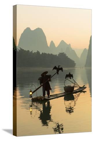 Cormorant Fisherman on Li River at Dawn, Xingping, Yangshuo, Guangxi, China-Ian Trower-Stretched Canvas Print