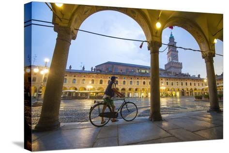 Piazza Ducale, Vigevano, Lombardy, Italy. Rainy Sunset and People.-Marco Bottigelli-Stretched Canvas Print