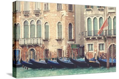 Parked Gondolas Along the Grand Canal of Venice, Veneto, Venice District, Italy-ClickAlps-Stretched Canvas Print