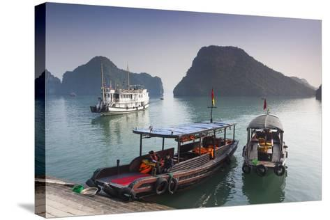 Vietnam, Halong Bay, Tito Island, Water Taxis-Walter Bibikow-Stretched Canvas Print