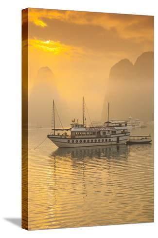 Vietnam, Halong Bay, Tourist Boats, Sunrise-Walter Bibikow-Stretched Canvas Print