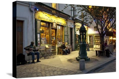 Store at Dusk, Paris, Ile-De-France, France--Stretched Canvas Print