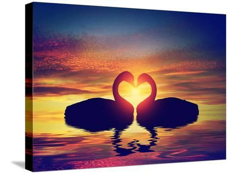 Two Swans Making a Heart Shape at Sunset. Valentine's Day Romantic Concept-Michal Bednarek-Stretched Canvas Print