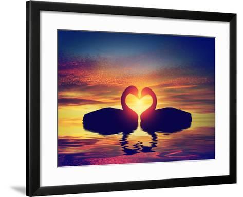 Two Swans Making a Heart Shape at Sunset. Valentine's Day Romantic Concept-Michal Bednarek-Framed Art Print