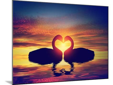 Two Swans Making a Heart Shape at Sunset. Valentine's Day Romantic Concept-Michal Bednarek-Mounted Photographic Print