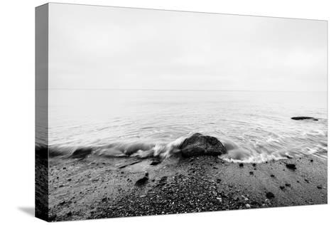 Nostalgic Sea. Waves Hitting in Rock in the Center. Black and White, far Horizon.-Michal Bednarek-Stretched Canvas Print