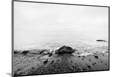 Nostalgic Sea. Waves Hitting in Rock in the Center. Black and White, far Horizon.-Michal Bednarek-Mounted Photographic Print
