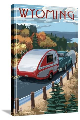 Wyoming - Retro Camper on Road-Lantern Press-Stretched Canvas Print