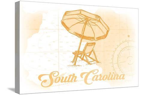 South Carolina - Beach Chair and Umbrella - Yellow - Coastal Icon-Lantern Press-Stretched Canvas Print
