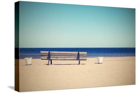 Wooden Retro Bench on the Sandy Beach Seashore-malven-Stretched Canvas Print