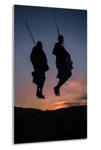 Two Masaai Warriors Silhouetted Performing Traditional Jump - Leap Kopje at Sunset-Nick Garbutt-Metal Print