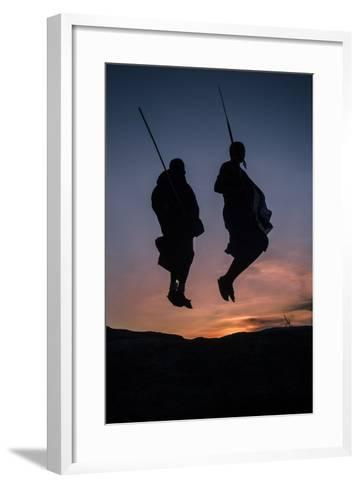 Two Masaai Warriors Silhouetted Performing Traditional Jump - Leap Kopje at Sunset-Nick Garbutt-Framed Art Print