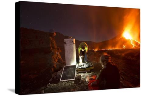 Scientists Observing Lava and Ash Plume Erupting from Fogo Volcano-Pedro Narra-Stretched Canvas Print