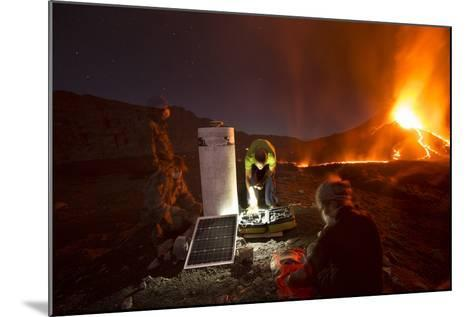 Scientists Observing Lava and Ash Plume Erupting from Fogo Volcano-Pedro Narra-Mounted Photographic Print