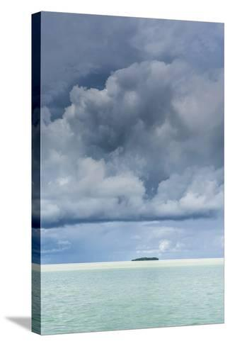 Dramatic Sky over a Little Island in the Rock Islands, Palau, Central Pacific-Michael Runkel-Stretched Canvas Print
