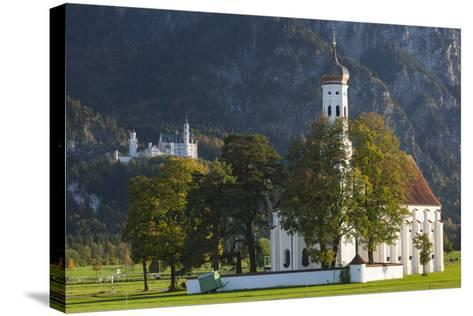 Germany, Bavaria, Hohenschwangau, Castle and St. Coloman Church, Fall-Walter Bibikow-Stretched Canvas Print