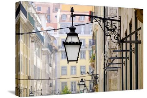 Portugal, Lisbon. Wrought Iron Street Lights on Corner of Building. Maritime Emblem-Emily Wilson-Stretched Canvas Print