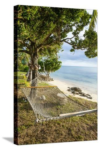 Hammock on a Beach in Ha'Apai, Tonga, South Pacific-Michael Runkel-Stretched Canvas Print