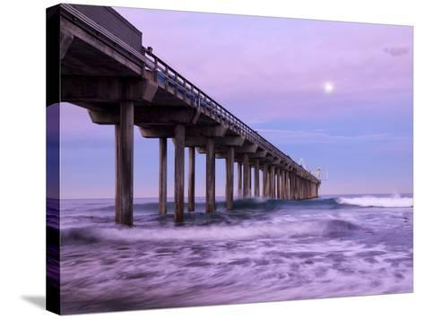 USA, California, La Jolla, Full Moon Setting at Dawn over Scripps Pier, La Jolla Shores-Ann Collins-Stretched Canvas Print
