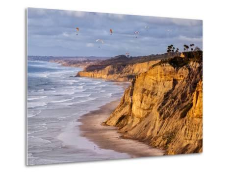 USA, California, La Jolla. Paragliders Float over Black's Beach in Late Afternoon-Ann Collins-Metal Print