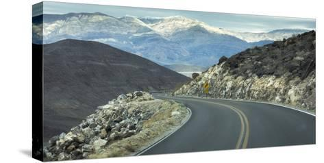Road with Curve Leading Through Mountains into Death Valley, California-Sheila Haddad-Stretched Canvas Print
