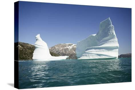 Greenland, Skjoldungen Fjord, Large Sculptural Icebergs with Scenic Snow Capped Mountains-Aliscia Young-Stretched Canvas Print