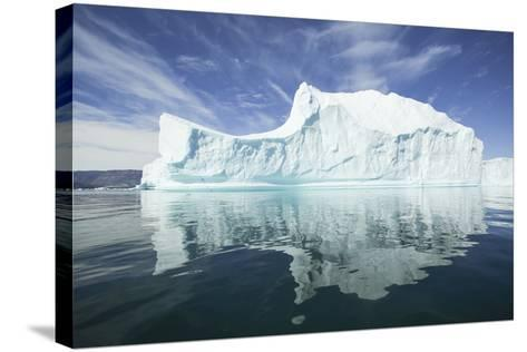 Greenland, Scoresby Sund, Red Island, Large Iceberg in a Small Ripple of Water-Aliscia Young-Stretched Canvas Print