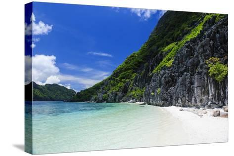 Little White Sand Beach in the Clear Waters of the Bacuit Archipelago, Palawan, Philippines-Michael Runkel-Stretched Canvas Print
