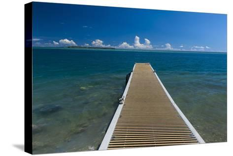 Pier with Cocos Island in the Background, Guam, Us Territory, Central Pacific-Michael Runkel-Stretched Canvas Print