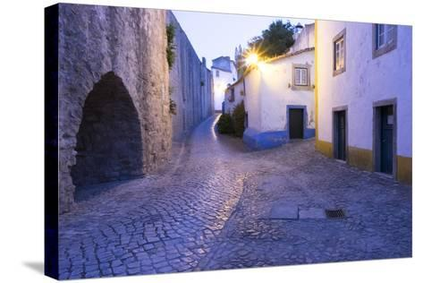 Portugal, Obidos. Leira District. Cobblestone Walkways, at Sunset-Emily Wilson-Stretched Canvas Print