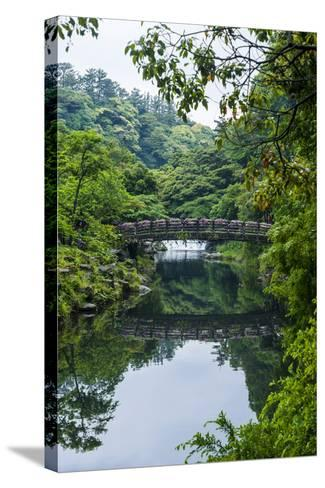 Stone Bridge with Flowers in Seogwipo, Island of Jejudo, South Korea-Michael Runkel-Stretched Canvas Print