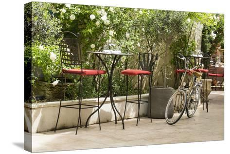Southern France, St. Remy. Sidewalk Cafes-Emily Wilson-Stretched Canvas Print