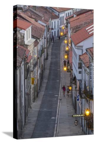 Spain, Santiago. Cobblestone Narrow Street Scene at Twilight-Emily Wilson-Stretched Canvas Print
