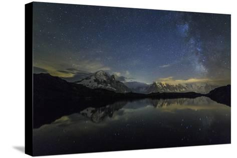 Stars and Milky Way Illuminate the Snowy Peaks and Lac De Cheserys, France-Roberto Moiola-Stretched Canvas Print