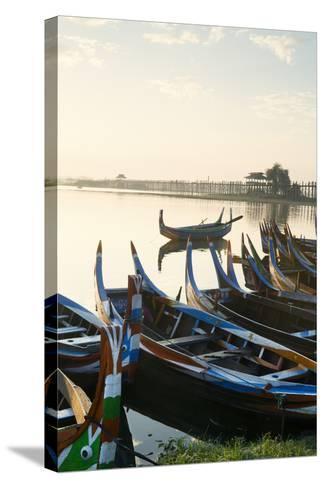 Boats on the Taungthaman Lake Near Amarapura with the U Bein Teak Bridge Behind, Myanmar (Burma)-Alex Robinson-Stretched Canvas Print