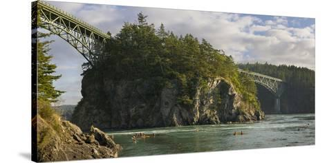 Washington, Sea Kayakers Play in Ebb Tidal Currents under the Deception Pass Bridge-Gary Luhm-Stretched Canvas Print