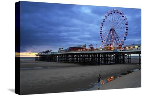 Big Wheel and Amusements on Central Pier at Sunset with Young Women Looking On, Lancashire, England-Rosemary Calvert-Stretched Canvas Print