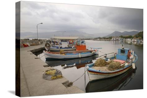 Moored Fishing Boats in Apothika Village Harbour, Greece-Nick Upton-Stretched Canvas Print