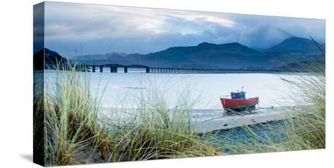 Fishing Boat with Barmouth Bridge in Background, Coast of Cardigan Bay, Gwynedd, Wales, U.K.-John Alexander-Stretched Canvas Print