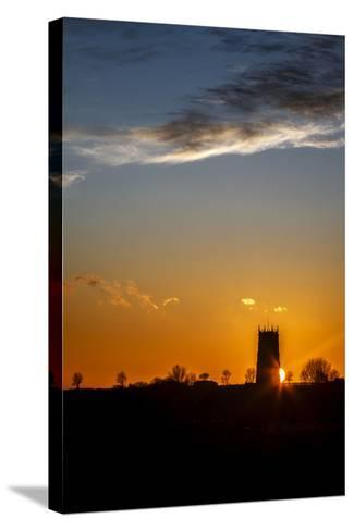 Sunset Behind the Parish Church of the Holy Trinity and All Saints at Winterton on Sea, England-Andrew Sproule-Stretched Canvas Print