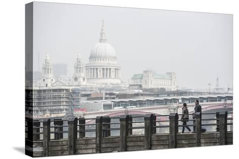 Couple on a Pier Overlooking St. Paul's Cathedral on the Banks of the River Thames, London, England-Matthew Williams-Ellis-Stretched Canvas Print