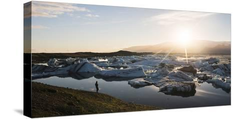 Tourist at Jokulsarlon Glacier Lagoon at Sunset, South East Iceland, Iceland, Polar Regions-Matthew Williams-Ellis-Stretched Canvas Print