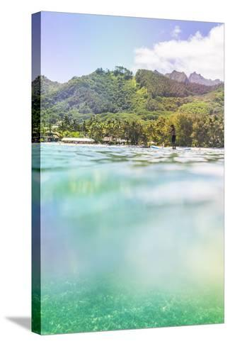 Paddleboarding in Muri Lagoon with Rarotonga in the Background, Cook Islands, Pacific-Matthew Williams-Ellis-Stretched Canvas Print