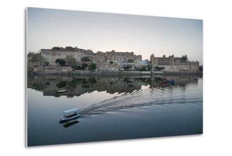 A Water Taxi Passing City Palace Reflected in Still Dawn Waters of Lake Pichola, Rajasthan, India-Martin Child-Metal Print