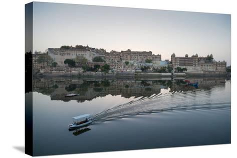 A Water Taxi Passing City Palace Reflected in Still Dawn Waters of Lake Pichola, Rajasthan, India-Martin Child-Stretched Canvas Print