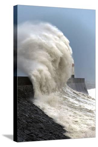 Huge Waves Crash Against the Harbour Wall at Porthcawl, Bridgend, Wales, United Kingdom, Europe-Graham Lawrence-Stretched Canvas Print