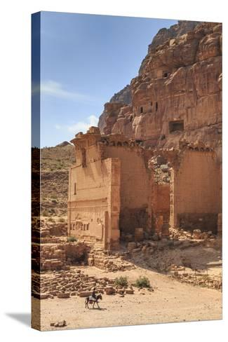 Local Man on Donkey Passes Qasr Al-Bint Temple, Jordan-Eleanor Scriven-Stretched Canvas Print