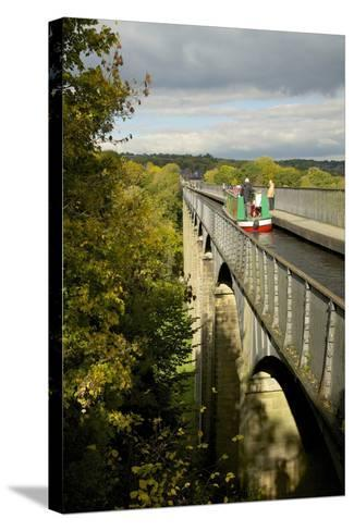 Narrowboat Crossing the River Dee in Autumn on the Pontcysyllte Aqueduct, Denbighshire-Peter Barritt-Stretched Canvas Print