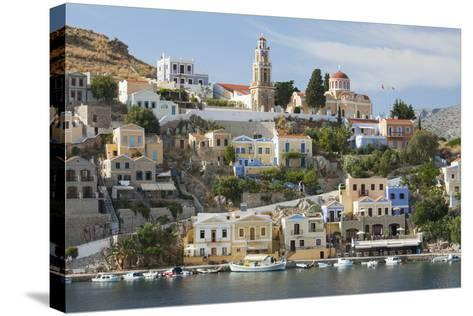 View over Harbour to Colourful Houses and Church, Dodecanese Islands-Ruth Tomlinson-Stretched Canvas Print